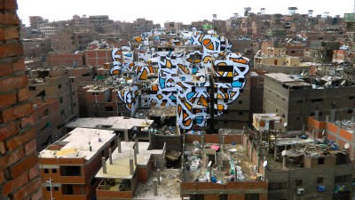 eL Seed: graffiti piece across 50 buildings